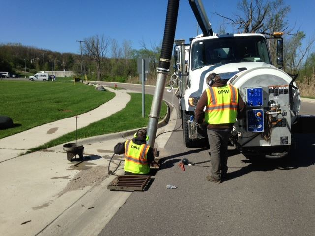 DPW Staff Cleaning Road Catch Basins